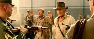 """Kingdom of the Crystal Skull"" opens with Indiana Jones and his associate Mac (Ray Winstone) facing gunfire from Russian soldiers."