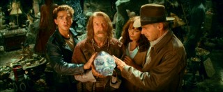 Mutt, Ox (John Hurt), Marion, and Indy huddle around the magnetically-charged crystal skull.