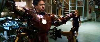Pepper Potts (Gwyneth Paltrow) walks into Tony Stark's workshop to see her boss struggling to get out of his iron suit.