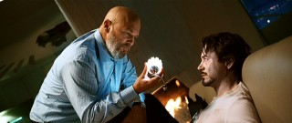Friendly conversation or something else? Obadiah Stane (Jeff Bridges) looks at the arc reactor keeping an unusually pale Tony Stark alive.