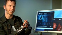 "HUD Design Supervisor Dav Rauch shows off his lovely fingerless gloves and ""The Visual Effects of Iron Man."""