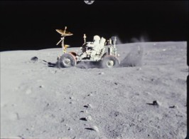 One of the astronauts goofs around on the lunar rover.