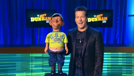 "Jeff Dunham and his beer-loving American redneck character Bubba J set up a sketch on what I believe is called ""The Jeff Dunham Show."""