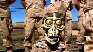 Bushily-eyebrowed dead terrorist Achmed discovers the U.S. Marines isn't the easiest way to American citizenship.