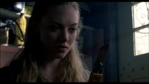 Needy (Amanda Seyfried) grimly eyes her weapon of choice for the confrontation to come in this deleted scene.