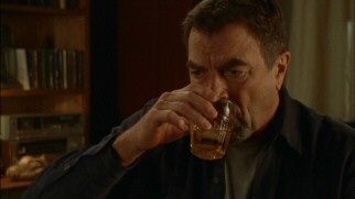 Jesse Stone loves Scotch. Scotchy Scotch Scotch. Here it goes down, down into his belly.