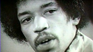 Jimi Hendrix talks about performing the same songs over and over again in this black & white talk show clip.
