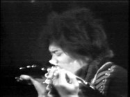 "Jimi Hendrix does a little guitar-playing with his teeth in The Experience's Marquee performance of ""Hey Joe."""