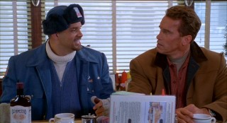 Sinbad goes postal as a mailman named Myron Larabee, seen here sharing some coffee and booze with Howard.