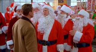 In this Extended Edition, Jim Belushi leads the Mall Santas in song. The abysmal central warehouse scenes are the ones most elongated in this barely-longer cut.