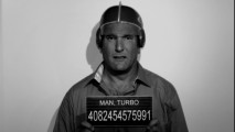 "Turbo Man's mug shot is seen in ""Turbo Man: Behind the Mask"", which catches up with the hero as he's fallen on rough times in ""E! True Hollywood Story"" fashion."