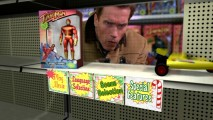 """Highlights"" from the movie keep the last Turbo Man company on an otherwise empty shelf. Arnold makes a funny face while making the animated RC car disappear!"