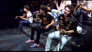 "The bleachers and Joe's patriotic sneakers may suggest rehearsal footage, but this bonus performance of ""Love Bug"" is in fact performed for a full live audience."