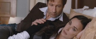 As their perfect image starts to crumble, Steve (David Duchovny) tries to get Kate (Demi Moore) to confide in him.