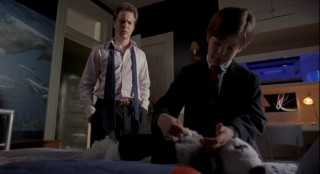 Joshua demonstrates the Egyptian method of embalming to his worried father (Sam Rockwell).