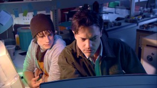 In Trevor's lab, he (Brendan Fraser) and his nephew (Josh Hutcherson) check out the tectonic situation.