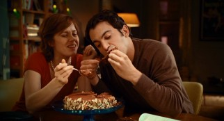 Julie's husband Eric (Chris Messina) enjoys eating this chocolate cake and other meals she prepares.