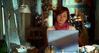 Amy Adams' performance as Julie Powell represents one of cinema's first depictions of a real life blogger. (As this shot illustrates, the film isn't above Sony's signature product placement.)