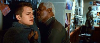 David gets an unannounced, unfriendly visitor in Roland (Samuel L. Jackson), who throws him up against the wall and gives him a close look at his silver hair.