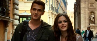David and Millie (Rachel Bilson) look content on an Italian walk.