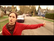 Juno is either giving a thumb up to this neighborhood's upkeep or hitchhiking in this deleted scene. You be the judge.