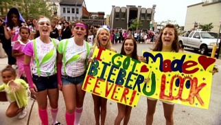 In every city, hordes of Beliebers gather to show their appreciation for Justin Bieber with customized clothing and poster board.