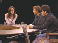"Keira Knightley warms her hands while taking part in ""The Roundtable Discussion."""