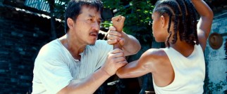Mr. Han (Jackie Chan) is a handyman in more ways than one, as he instructs Dre with a firm grip.