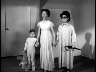 Kathryn Beaumont stands between Tommy Luske (left) and Paul Collins (right), who voiced and modeled for Wendy's younger brothers Michael and John Darling, respectively.