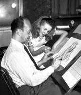 As Alice, Kathryn Beaumont checks up on an animator's rendering.