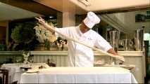 The executive pasta chef of Beverly Hills' Mr. Chow restaurant shows off his noodle-making skills.