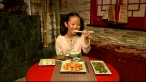 "This Asian girl sure seems happy to demonstrate ""How to Use Chopsticks."""