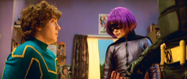 Nobody-turned-superhero Dave Lizewski/Kick-Ass (Aaron Johnson) is paid a house visit by Hit Girl (Chloë Grace Moretz) and her Big Daddy.
