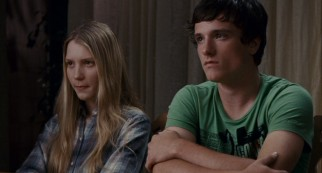 Joni (Mia Wasikowska) and Laser (Josh Hutcherson) have a talk with their two moms.
