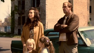 Danny's wife Joan (Linda Cardellini) is unimpressed by the slummy neighborhood their young family will next call home.