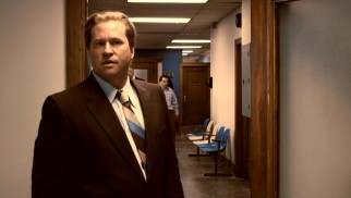 Police detective Joe Manditski (Val Kilmer) is less prominent in the film than his narrating duties suggest.