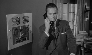 Though old-fashioned in many ways, Mike Hammer (Ralph Meeker) is ahead of the times as far as telephone answering machines go.