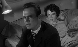 Sweaty secretary Velda (Maxine Cooper) clearly has eyes for Mike Hammer (Ralph Meeker), but his mind is on milk and other more important matters.