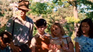 Kit and her friends learn about hobo symbols from their hobo friend Will Shepherd (Max Thieriot).