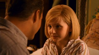 Kit gets some great Depression reassurances from her unemployed father (Chris O'Donnell).