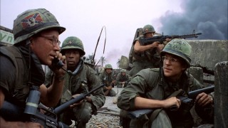 Private Cowboy (Arliss Howard, left) calls to request the assistance of a tank, while Animal Mother (Adam Baldwin, rear right) keeps watch with his rifle and our protagonist Private Joker (Matthew Modine, right) looks on. This image comes from the beginning of the film's climactic military finale.