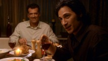 Mr. Trager (Bruce Thomas) is visibly amused to have the charismatic Michael Cassidy (Hal Ozsan) as his dinner guest.