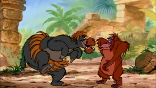 "Baloo (feebly disguised as a female orangutan, thanks to coconut and bamboo) and King Louie make for one rollicking scat duo in the outstanding musical number ""I Wan'na Be Like You."""
