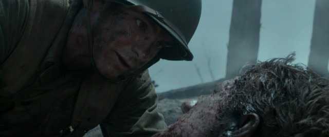 Desmond Doss (Andrew Garfield) doesn't need to bear arms to make a difference for his fellow soldier on the battlefield.