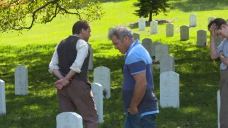 "Mel Gibson directs Hugo Weaving and Andrew Garfield in a cemetery scene in making-of documentary ""The Soul of War."""