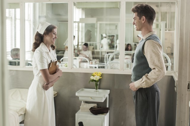 "Before shipping off, Desmond Doss (Andrew Garfield) falls for nurse Dorothy Schutte (Teresa Palmer) in scenes reminiscent of the non-action parts of ""Pearl Harbor."""