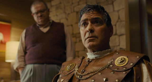 "Movie star Baird Whitlock (George Clooney) is abducted by Communist screenwriters off the set of ""Hail, Caesar!"""