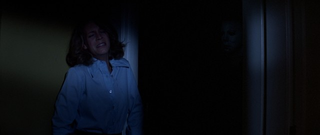 Look closely and you'll catch a glimpse of the mask of the man terrorizing Laurie Strode (Jamie Lee Curtis).