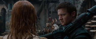 Hansel (Jeremy Renner) performs an ocular patdown, clearing an accused with on the basis of her dental hygiene.