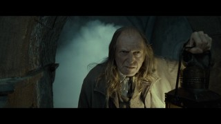 Smoke billows behind Hogwarts groundskeeper Argus Filch (David Bradley) in this short deleted scene.